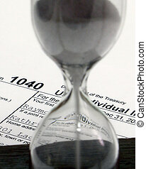 Tax Time - Hour glass and 1040 form tight