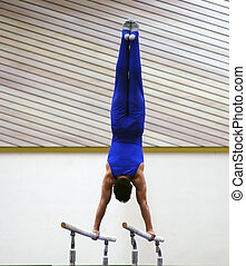 At the gym - Young gymnast competing on parallel bars