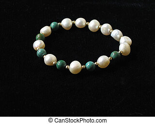 Pearls and Jade - Pearl and jade bracelet, black background...