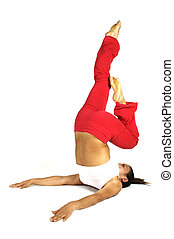 Yoga Stretch - A female fitness instructor demonstrates a...