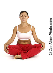 Relaxation - A female fitness instructor demonstrates a yoga...