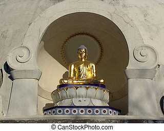 statue in arch - golden statue of sitting buddha
