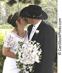 Kissing couple - kissing couple at wedding