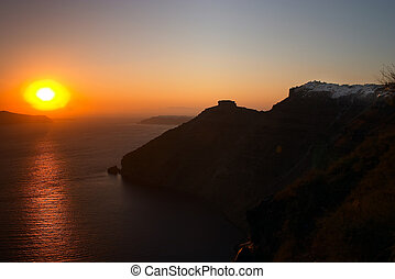Greek sunset - Sunset over Santorini, with part of Fira town...