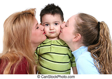 Children Boy Girl - Toddler boy being kissed by two...