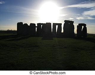 Stonehenge - Silhouetted image of stonehenge on sunny day
