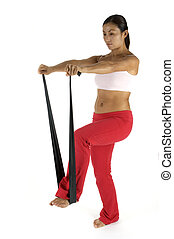 Fitness Training - A female fitness instructor demonstrates...