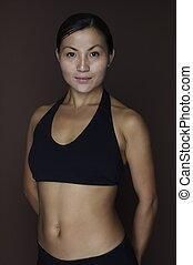 Asian Female 2 - An asian fitness instructor in sportswear...