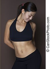 Asian Female 3 - An asian fitness instructor in black...