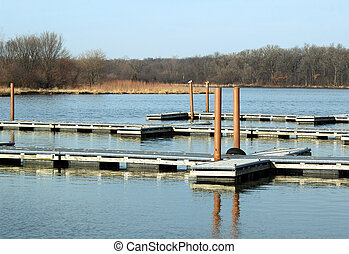 Boat Dock - This photo is of a vacant boat dock with...