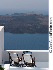 volcano view - Deckchairs at a hotel on Santorini,...