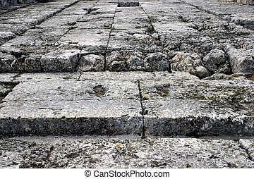 Stone floor - Decayed stone floor from ancient greek temple.