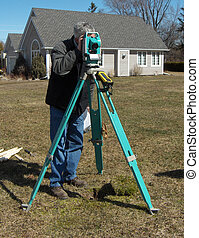 Surveyor - man surveying a vacant lot