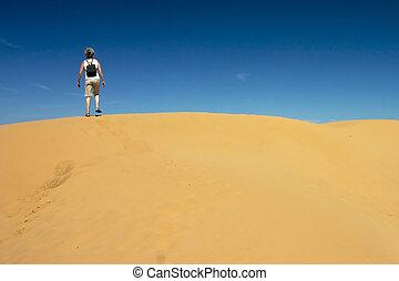 Alone @ Sand Hill 02 - Senior Woman climbing a sandhill