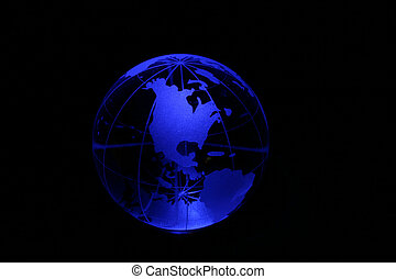 Globe in blue light - Planet earth as crystal ball in blue...