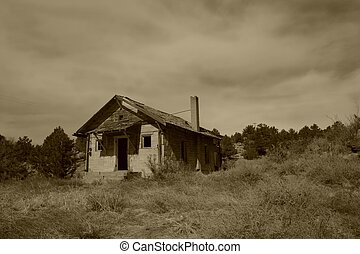 Haunted House Sepia - Rustic, historic abandoned building in...