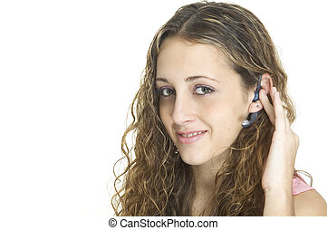 Hands-Free - A pretty female talks on a hands-free wireless...