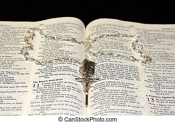 rosary bible 1 - A rosary inside of a bible