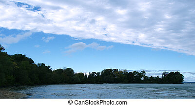 Cottage landscape - Northern Ontario shoreline with blue sky...