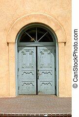Blue Doors - Massive wooden blue doors invite worshippers to...
