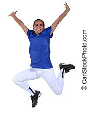 Victory Dance - Teen in softball uniform jumping for joy...