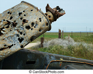 Muffler Shot - Bullet holes in rusted muffler