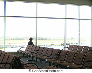 Airport wait. - A lone man waits in an empty airport...