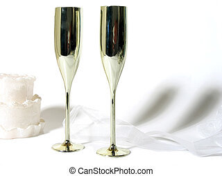 Cake and Champagne - White cake, gold champagne flutes and...