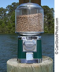 Coin Feeder - Coin operated feeder for feeding wildlife,...