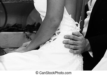 wedding day - Bride and groom sitting together on their...