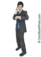 Arrange - An asian businessman arranges a meeting by phone