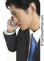 On The Phone - An asian businessman talks on the phone