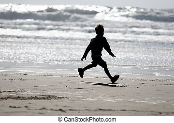Boy on the beach - Boy running on the beach