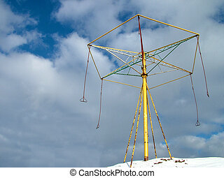 Lets swing - Swing mechanism in natural sky, winter time