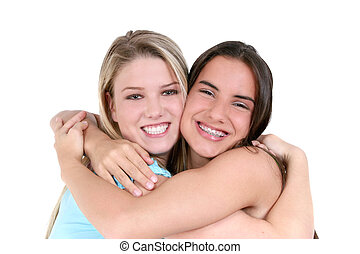 Teen Girl Friend - Two teen girls smiling and hugging over...