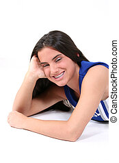 Teen Girl Braces - Teen in cheerleading uniform laying on...