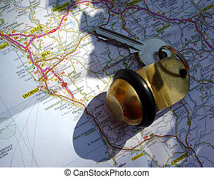 travelling - hotel room key on a map in natural sunlight