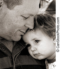 daddy - baby with head on fathers shoulder in black and...