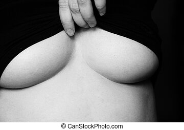 Womans breasts - Woman lifting her top to expose her breasts...