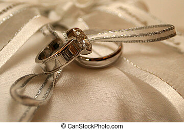 rings on silk - wedding rings lying on silk
