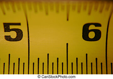 By The Inch - Close-up of tape measure