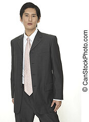 Businessman 16 - An asian businessman in a smart grey suit...