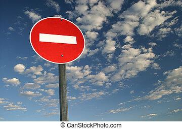 No Entry - No entry sign against blue sky