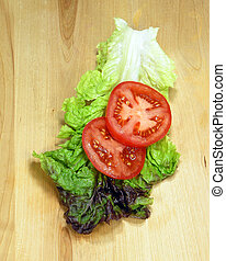 Veggies on Wood - Lettuce and tomatoes on wood cutting board