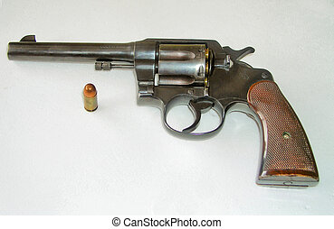 Gun and Bullet - 45 caliber revolver and one bullet