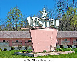 Pink Motel - Old pink motel with blank sign and a 1 star...