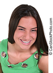 Teen Girl Braces - Portrait of beautiful teen girl in...