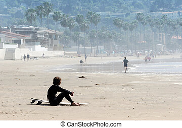 Lonely surfer at the beach