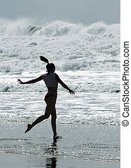 Going in - Girl running into ocean
