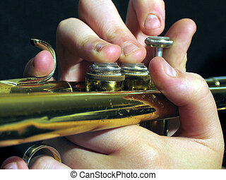 trumpet player - hand playing a trumpet